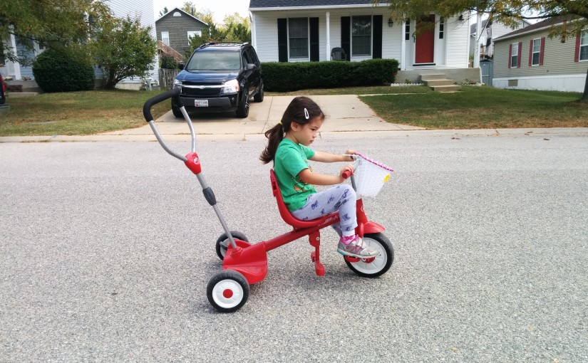 Scarlett riding tricycle