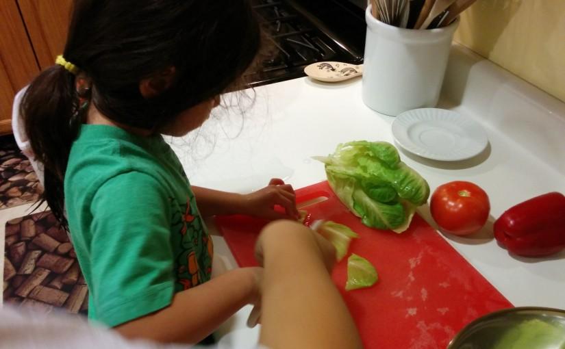 Scarlett cutting lettuce